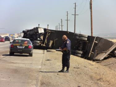 This big rig is said to have reached speeds of 85 miles per hour down the Grapevine before crashing on northbound Interstate 5, directly across from the CHP/truck scales near Mettler. [photo by Gary Meyer of The Mountain Enterprise]
