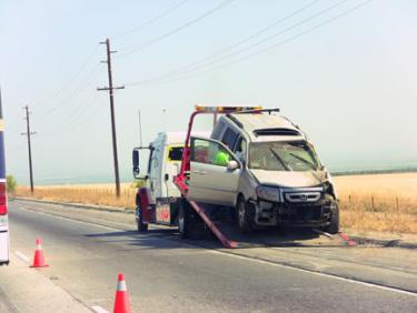 The Honda Pilot which was struck after a CHP unit hit the rail next to the number one lane. [photo by Gary Meyer of The Mountain Enterprise]