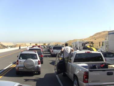 An overturned big rig reached speeds of 85 miles per hour before crashing on Interstate 5, directly across from the CHP weigh scales near Mettler. Motorists had little to do to keep them occupied for an hour while the accident scene was cleared on Saturday, July 3.