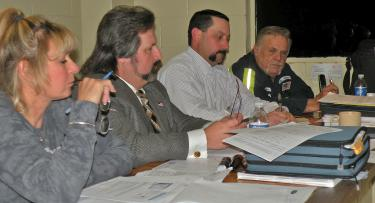 Questioning by the Lebec County Water District board (shown in file photo above) led to a decision to place secretary Michelle Miller Gustafson on investigative leave August 5. Her employment was terminated for inadequate secretarial skills on August 10 at a special meeting of the board. Philip Aaland, the newest member of the board, was helpful in identifying discrepancies. Above, Julie McWhorter, Steve Cozzetto, Darren Hager and Jack Rider all worked to uncover major problems with billing and deposits.