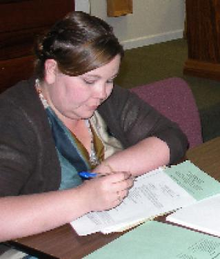 Michelle Miller Gustafson (above) took notes in a meeting of the Lebec County Water Board in April. Miller Gustafson was placed on investigative leave August 5. Her employment was terminated for inadequate secretarial skills on August 10 at a special meeting of the board, which had discovered major problems with billing and deposits.