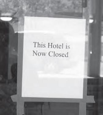 Sign taped to Best Rest Inn door