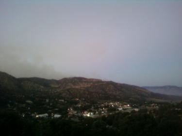 This shot by Dylan Keenberg at about 7:30 p.m. is looking down on the hamlet of Frazier Park from his family home at the peak of Oakmont Trail. In contrast to those taken in the valley, this photo shows the fire has mellowed on the ridge, he said. Keenberg wrote earlier that from his perch it appears the fire is most active in a direction away from the town. In this more comprehensive picture, the fire looks like it is settling down, he said.