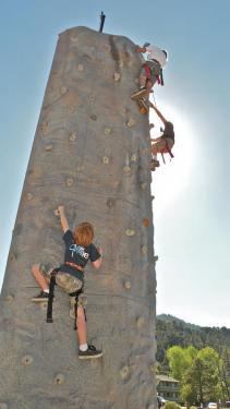 Cousins Luke Johnston, 7 and Noah Stolper, 13 of Thousand Oaks scale the Oktoberfest climbing wall with a friend. Noah's dad brought them because he used to come to Oktoberfest when he was a child.