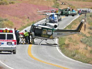 David Mitchell, 47 is transferred by American Medical Response (AMR) ambulance paramedics and Kern County Fire Department personnel from KCSO helicopter 5 to waiting Mercy Air in the middle of Cuddy Valley Road at about 3 p.m. Sunday, Sept. 12.
