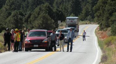 Eastbound motorists on Cuddy Valley Road got out of their cars to wait at U.S. Forest Service roadblock of Cuddy Valley Road on Sunday, Sept. 12 as medevac between two helicopters was coordinated. The helicopters departed by about 3:30 p.m. and traffic was allowed to continue. [Photo by The Mountain Enterprise]
