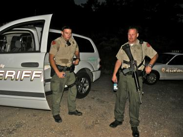Deputies Kevin Moretti and Jeff Eveland just after hiking back up from the site of a pot farm discovered Sunday in rugged terrain within a half mile of Pine Mountain homes.