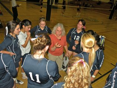Coach Sharon Lemburg tells the varsity volleyball Falcons not to let the Kern Valley Broncs get the ball. [Hedlund photo]