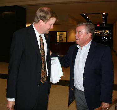 Adam Keats, attorney for the Center for Biological Diversity greets Tejon Ranch Company CEO Bob Stine outside the Kern County Board of Supervisors chambers last year. CBD's lawsuit against the county and Tejon Mountain Village won no points with Judge Twisselman last week.