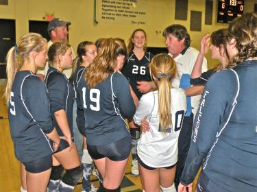 Intense Coaching and Talent: A Falcon volleyball dynasty is being built. Above, Chuck Mullen and Jason Jens coach the unbeaten junior varsity Falcon volleyball team.