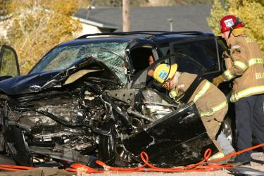 Kern County Fire Station 57 crew members prepare to extricate the driver of a Toyota Rav4. [photo by The Mountain Enterprise]