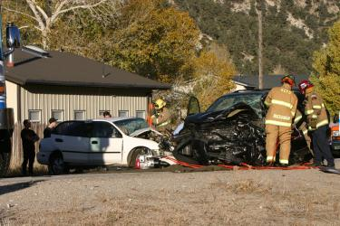 The two vehicles in the middle of Frazier Mountain Park Road after colliding head-on. [photo by The Mountain Enterprise]