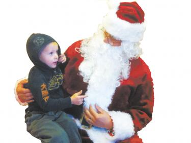 Santa at Chatterpillar Toys, Gifts and Balloonsdelights Cruz Noller.