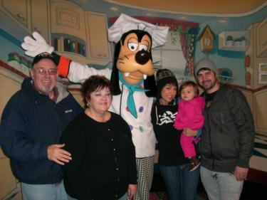 Mike and Dorris Riccomi sent this photo with Disneyland's Goofy, daughter Sarah Dutra, their 11-month-old granddaughter Hazel and son-in-law Vic Dutra. The family was stranded in Lebec when the Grapevine closed down, and all available rooms were taken. They called from San Jose after they finally got home on Tuesday, Jan. 4 to thank those who they said had been so hospitable and compassionate to them.