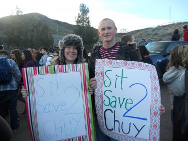Joey Teare and Alex McCue holding signs saying Sit 2 Save Chuy at the peaceful demonstration at Frazier Mountain High School on Thursday, Jan. 27, 2011. [Photo by Katy Teare]