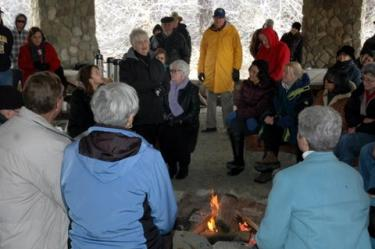 Friends and family gathered around a campfire in a Wind Wolves Preserve pavilion to share stories and memories at the memorial for Dale Chitwood February 26. [Harry Nelson photo / Special to The Mountain Enterprise]