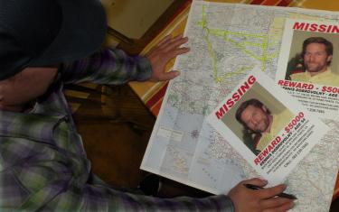A family member shows the map the Dobrovolny family has been using to split up the area among their team to canvas with flyers asking for help and offering a $5,000 reward for information leading to finding Dennis Dobrovolny.[Hedlund photo/ The Mountain Enterprise]