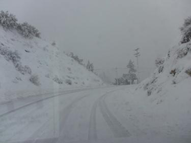Eastbound Mil Potrero Highway at the top of the S-curves near Ward Drive, at 8:41 a.m. Sunday. Mil Potero Highway was passable with 4x4 and/or chains or studded snow tires. [Mountain Enterprise photo]