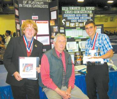 Frazier Mountain High School science teacher Barry Lindaman (center) came to the Kern County Science Fair awards ceremony to support his students, sophomore Forrest Csulak (left) and junior Josh Arreola.