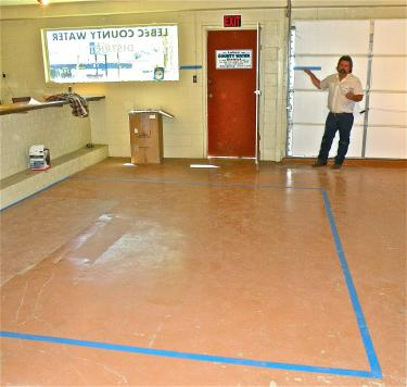 Imagine a doughboy swimming pool that is 12 feet wide by 12.5 feet long and 5 feet deep, says Steve Cozzetto of the Lebec County Water District. Those dimensions are taped out on the water company's office floor, and up the wall (shown above), to illustrate the volume that 750 cubic feet, or 5,610 gallons of water would fill.