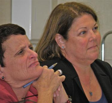 ETUSD financial manager Terri Geivet and Superintendent Katie Kleier listen to report about suggestions from parents to improve the district schools.[Patric Hedlund photo for The Mountain Enterprise]