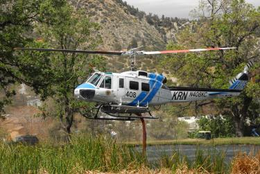 Richard Miseroy took this photos of Kern County Fire Department's helicopter 408 taking water from the pond in Frazier Mountain Park to fight the fire. Lot clearance is due by June 15. High fines will be levied on those who do not clear their lots this year.