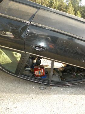 This open case of Newcastle Ale was cradled in the upside down roof of the car while ambulance personnel attended to the driver.