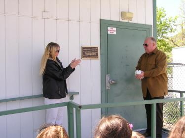 Board members Patty Edwards and Steve Sonder unveil the dedication plaque.