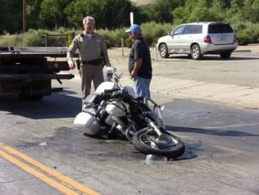 A mangled motorcycle in the middle of the northbound lane of Lebec Road, in front of the post office where, witnesses say, a white pickup truck pulled out in front of the motorcycle which was traveling northbound. [photo by The Mountain Enterprise]