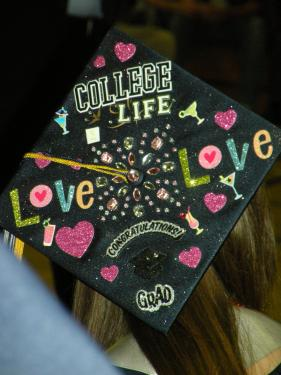 The hats themselves have become works of art for many of the excited graduates. This one was made by ASB President Danielle Culver.[Hedlund Photos]