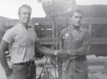 Al Fleming in 1961 at 17, meeting Elvis Presley (right) while Presley was filming &quotFollow That Dream&quot in Florida. Fleming became a stand-in and stuntman for the superstar, then accepted an invitation to work for Elvis in Hollywood.