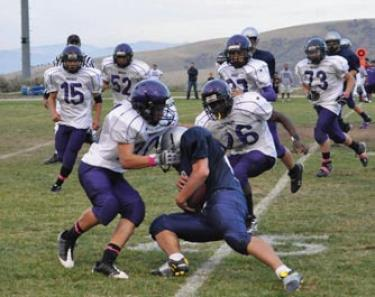 Scene from 2010 game with the Frazier Mountain High School Falcon football team. [Woerter Photo]