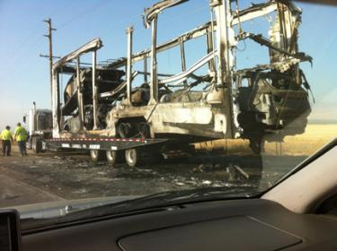 Harry Spyrka of Ace Hardware sent this photo of the charred BMW and Mini Cooper vehicle remains, still in the transport trailer at the I-5 shoulder.