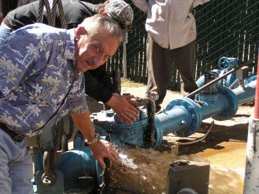 Jim Parsons (president of Krista Water Company) checks the water flow from the newly installed pump which became operational Thursday at 3:30 p.m. Krista service was returned to homes but residents must boil water until the state tests give an