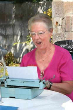 Co-Founder Nedra Hawley at the 40th birthday party for The Mountain Enterprise in 2005. Hawley began the newspaper in 1966 with her blue manual typewriter on which the paper was first created, in her family's basement. The typewriter is now on display at the Ridge Route Communities Museum.