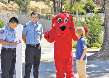 On September 17 Clifford The Big Red Dog was a bright beacon at the entrance to the Festival of Books. Police Explorer Cadetshelped Clifford greet the children and give them books of their own as gifts. Rotary Club of Frazier Park and the Mountain Communities coordinated the event.