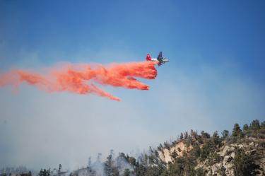 Debra Wash shows the efforts of fixed wing craft to lay fire retardant across the ridges to stop the downhill westward push of two prongs of the fire. Firefighters reported what they call &quotspotting.&quot Flying embers were starting smaller scattered fires.