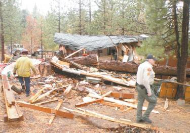 Kern County deputies and firefighters responded to what appeared to be the scene of a bombing. The impact of the tree falling on the house exploded the Storz home, sending timbers flying. Devin Storz, asleep in his bed, was killed instantly as his father was making coffee in the kitchen.[Hedlund photo for The Mountain Enterprise]