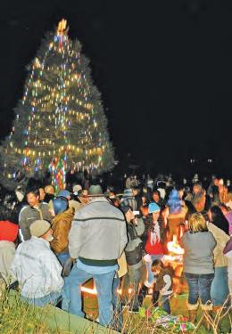 Almost like a festive &quotflash mob&quot about 180 people suddenly appeared out of the darkness to watch the annual lighting of the Pine Mountain Club POA Christmas tree, sip hot cocoa, sing some carols and then they vanished again into the night. Last year less than a third of this number attended, some parents observed.