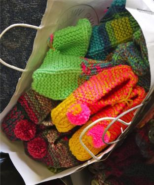The Pine Mountain Scrappers brought 100 pairs of beautiful, cheerful knit slippers for the children of the Jamison Center, serving children at risk. [Mary McDevitt photo]