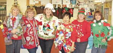 The post office staff display their handiwork for Ugly Sweater Day (l-r) Patty Farner, Kathy Gilbert, Mary Bollman, Lily Bellah, Lori Woten and Vicki Durst.