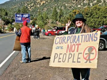 Mindy Moffat began the local group after visiting Occupy L.A. It has greeted motorists on Mil Potrero Highway for over two months, every Saturday morning (9 a.m.-noon) and Sunday afternoon (noon-2:30 p.m.).