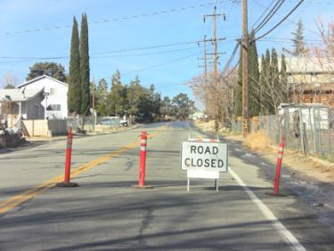 Mt. Pinos Way was expected to be closed most of Tuesday, while crews repair the leak. [photo by The Mountain Enterprise]