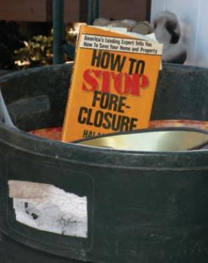 A book on &quotHow to Stop Foreclosures&quot was spotted in the trash of local family moving to a rental after giving up a 7-year fight to get a loan modification from the Bank of America.