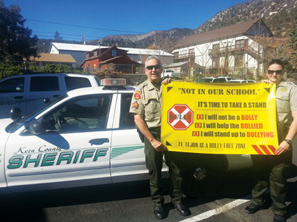 Sergeant Mark Brown and Deputy Rebecca Karr support the Anti-Bullying 'Time to Take a Stand' campaign in Mountain Community Schools. [photo by Scott Robinson]
