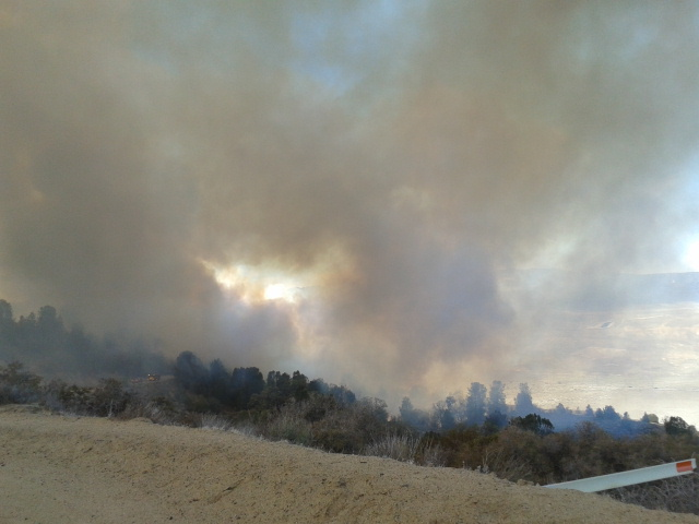 Brush fire at Highway 138 and Old Ridge Route was called in to 911 at about 12:50 p.m. This photo taken at about that time is by Joan Kotnik of Lake of the Woods, who is east of the fire at a ranch in the area.