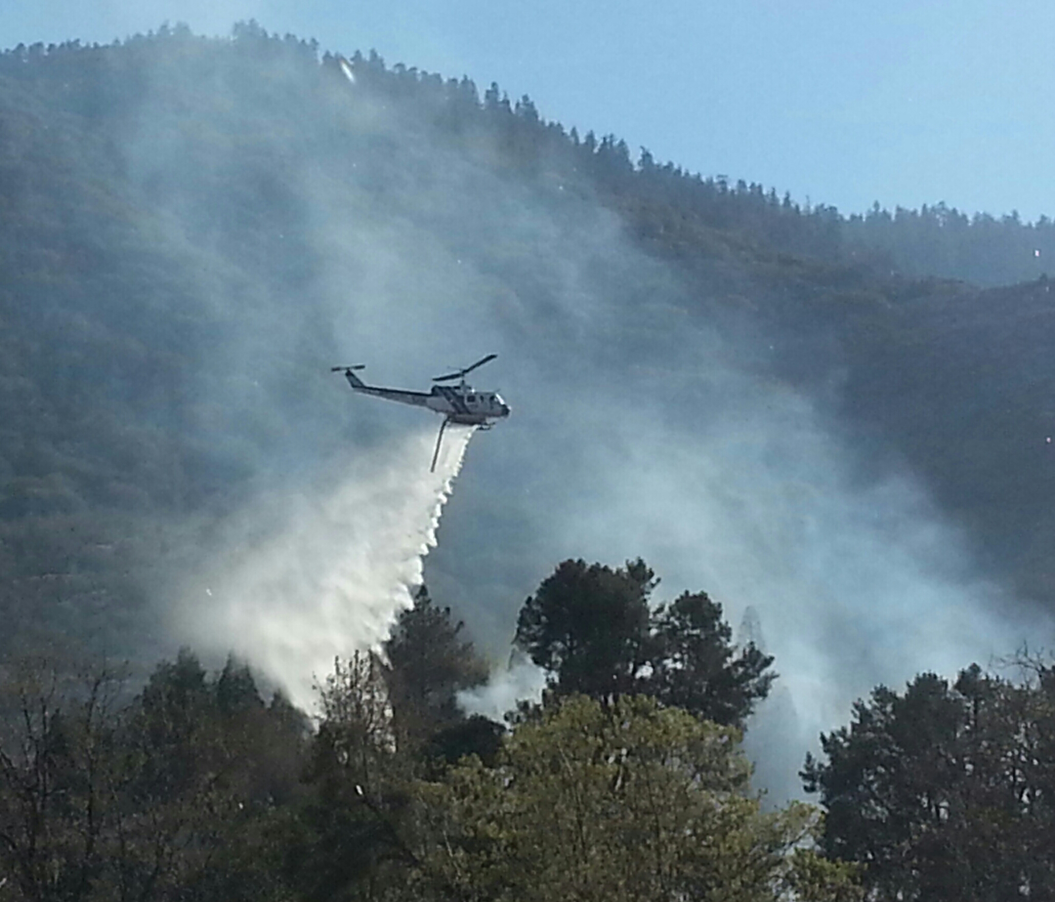 Scott Robinson sent this photo of the fire being extinguished by Kern County helicopter 408 plus ground crews in Frazier Park. (4:40 p.m. appx)