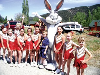 From the memory books: The Pine Mountain Rockettes and one Cub Scout with Bugs Bunny at a Lilac Festival of the past. This Saturday, the 32nd Annual Lilac Festival Parade opens at 10:45 a.m. sharp. Be early! [photo by Patric Hedlund]