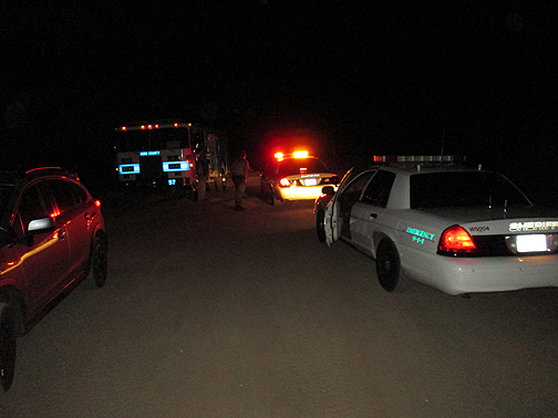 Kern County sheriff's deputies meet with fire station 57 personnel on Saturday evening, October 19 at about 9 p.m. regarding a medical emergency which turned out to be a fatality at a campground north of Cuddy Valley. [photo by Gary Meyer, The Mountain Enterprise]