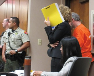 Above: Bufford's defense attorney shielded him with a file folder from being seen in the courtroom at the preliminary hearing May 23, 2018 at the Lamont branch of the Kern County Superior Court with families looking on.